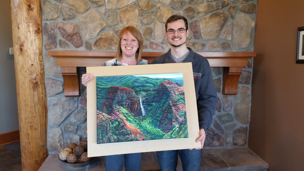 Ben handing off his painting of Waipoo Falls in Waimea Canyon!