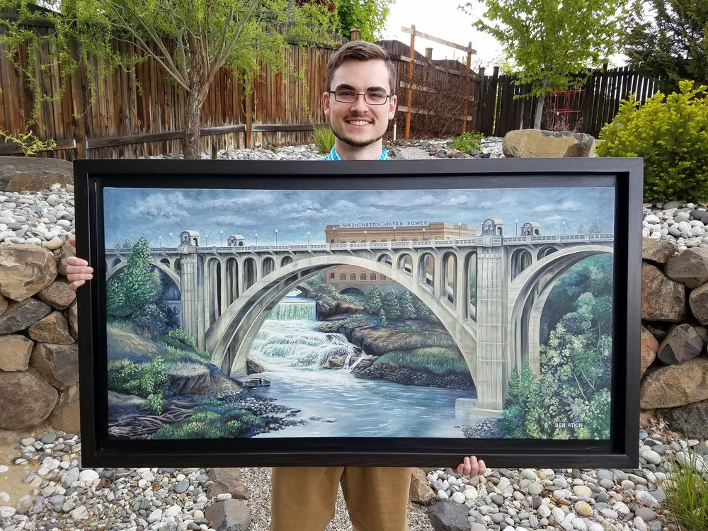 Ben holding his painting of the Monroe Street Bridge.
