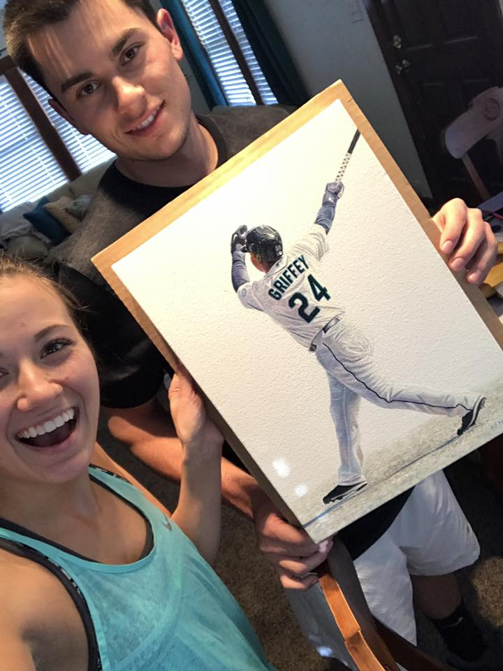Shelby and Kade with their painting of Ken Griffey Jr.'s famous swing!