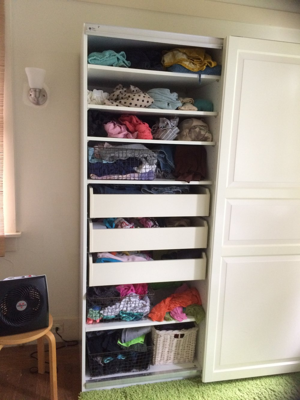 My side of the bedroom armoire.