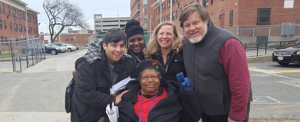 Rev Annie Chambers (center) right after winning her election for Housing and Urban Development's Baltimore Resident Advisory Board  Representative for Douglass Homes. She's with her campaign team (from left to right) Ian Schlakman, Tracey Smith, Margaret Flowers and Kevin Zeese.