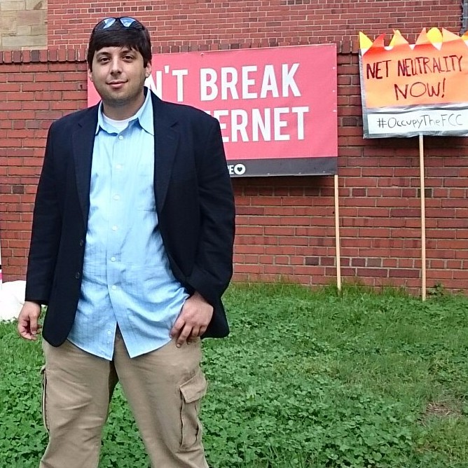 Ian outside of the 2014 Occupy the FCC rally to demand Net Neutrality