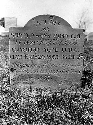 A headstone inscribed with the Deseret Alphabet in the Cedar City cemetery.