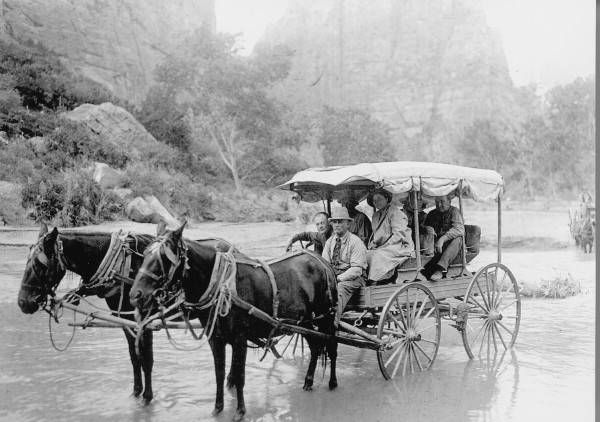 Gronway driving his Mountain Wagon across the Virgin River.