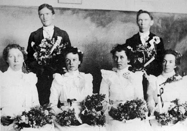First Graduating Class 1900 Standing: Joseph T. Wilkiinson jr. and J. S. Dalley Sitting: Emma Gardner, Alice Reed , Amelia Dalley, and Ella Beny