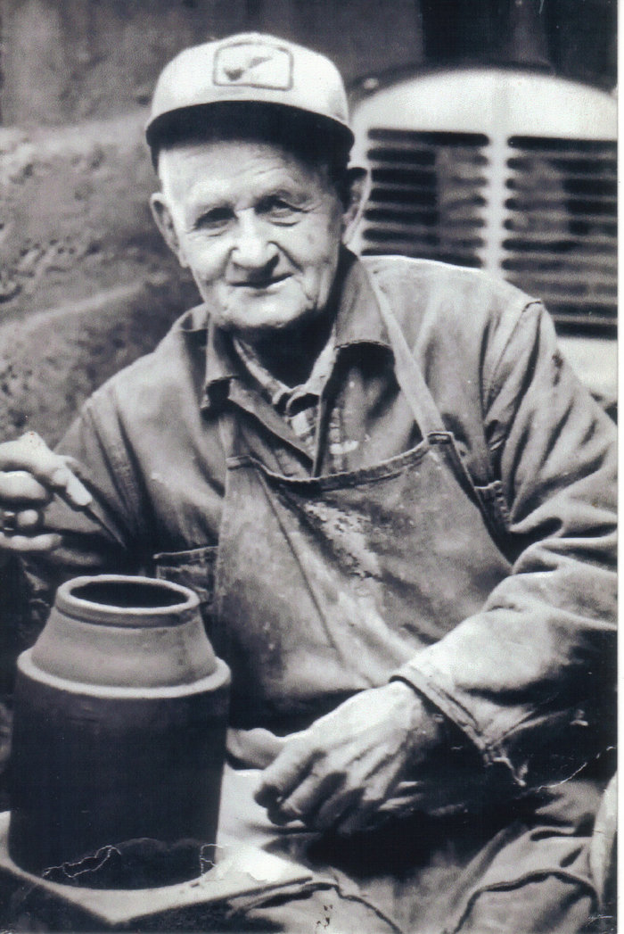 Amos Hatch in his pottery