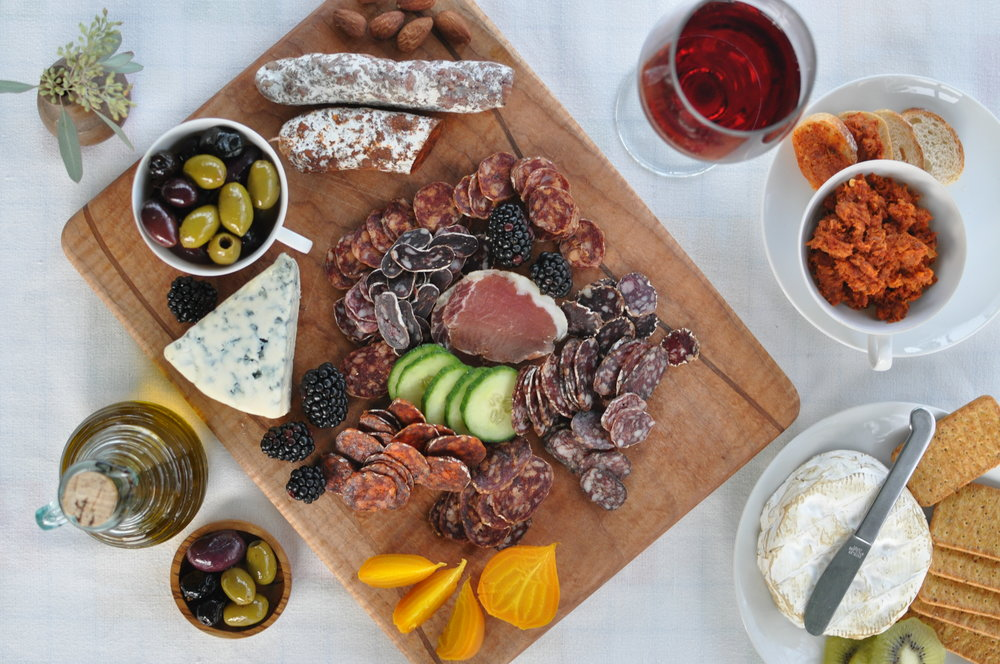 Clark Fork Charcuterie dry-cured meats on a board with accoutrements.