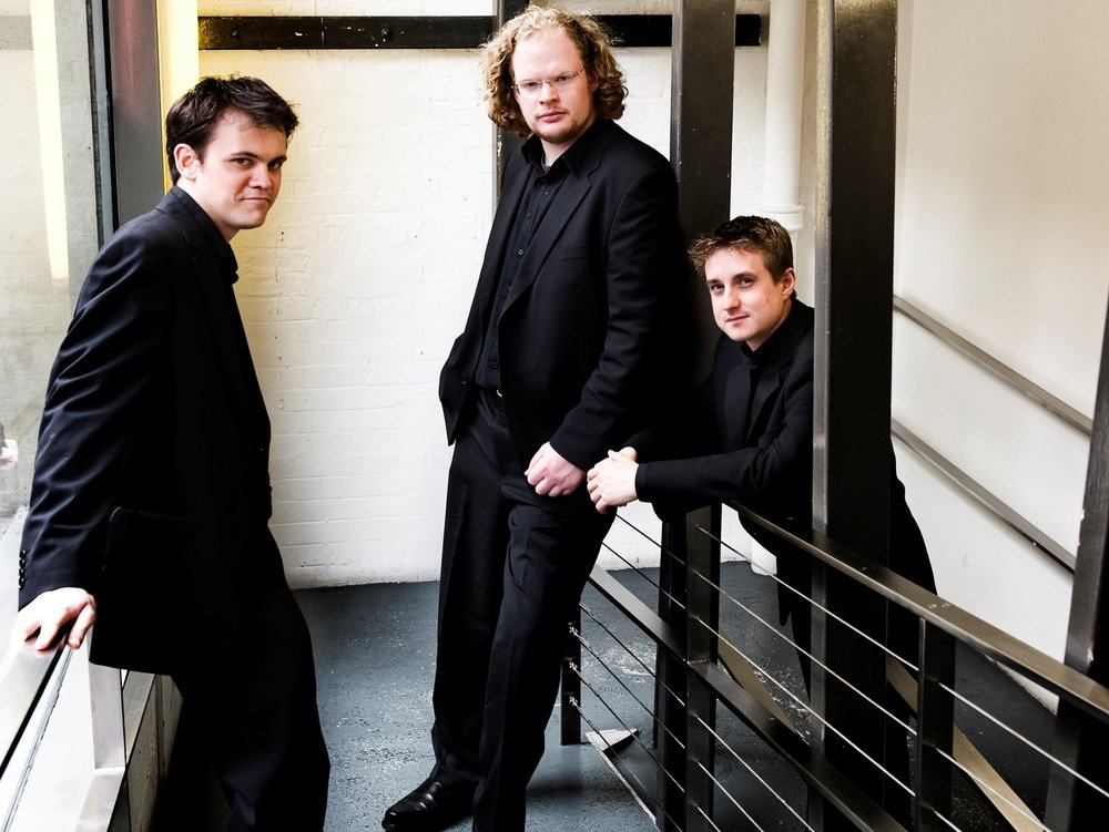 All three members of the Rhodes Piano Trio enjoy great success individually, Robert Thompson (piano) completing his solo studies with Peter Frankl at Yale University, David Edmonds (cello) with Gregor Horsch in Dusseldorf and Michael Gurevich (violin) as a member of the London Haydn Quartet.