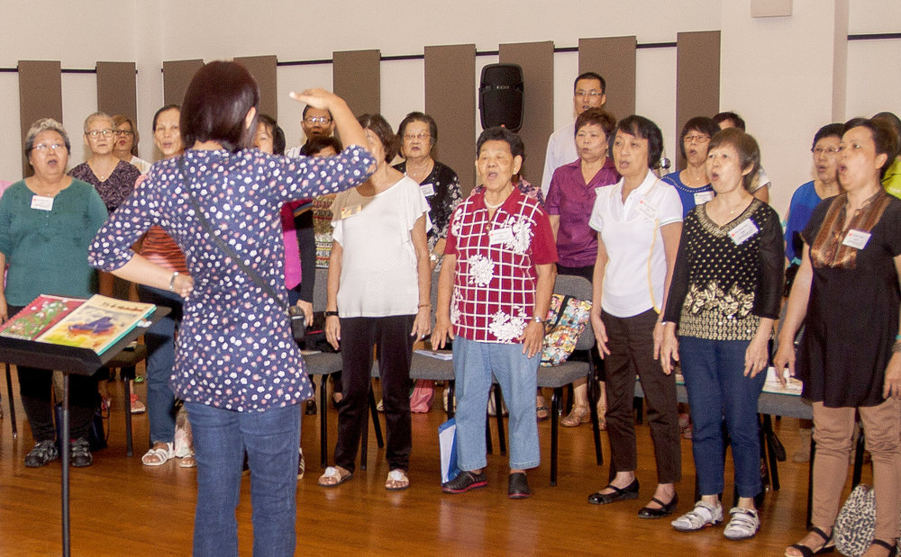 Senior Citizens Choir, in association with NUS Society Choir & National University Health System (NUHS), rehearse in YST Orchestra Hall.