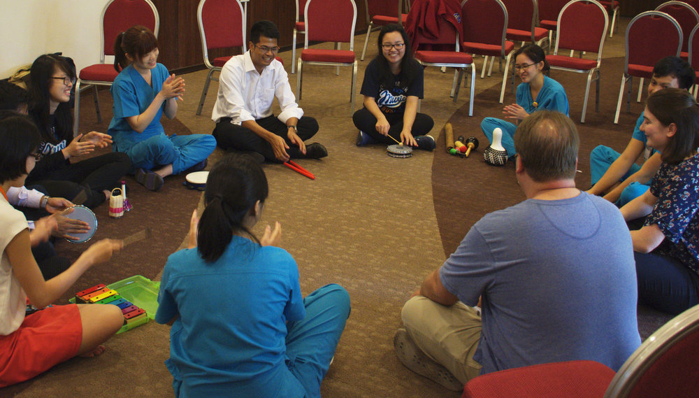 Above: Second year YST students and faculty facilitate a music workshop for staff at Sengkang Health