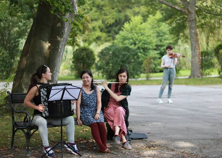 Rachel (on right) with fellow NAIP participants, finding new audiences during a performance in a park