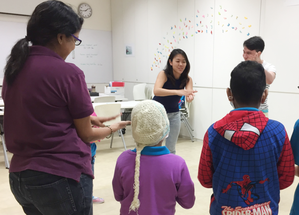 Rachel facilitates a body percussion workshop at the Children's Cancer Foundation Learning Centre