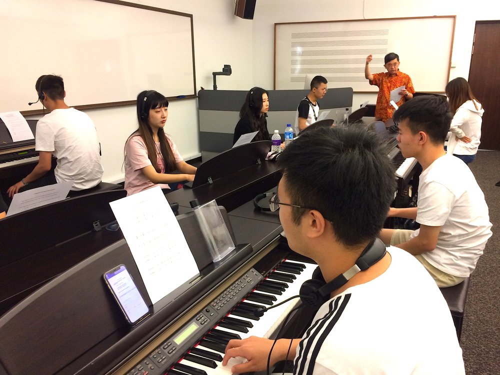 Dr Koo Siaw Sing engaging students in a spontaneous musical play session.