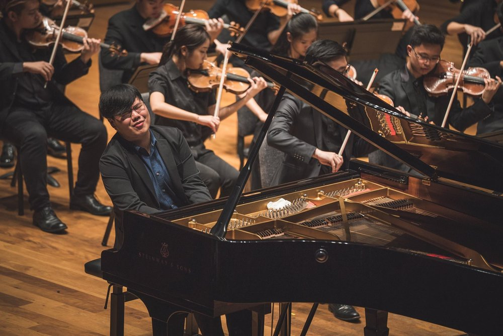 Tzu Kuang at the Concerto Competition grand finals with the Yong Siew Toh Conservatory Orchestra