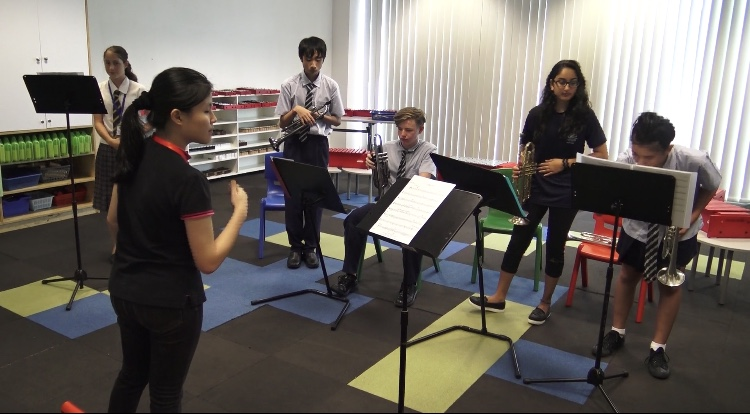 Hui Ping conducting a trumpet sectional.