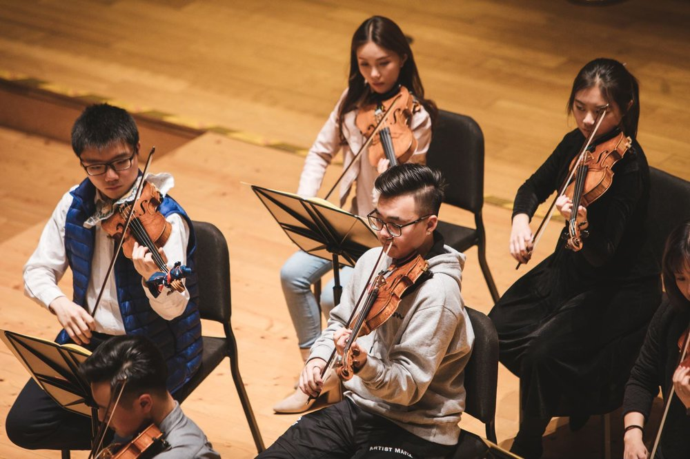 Seen in sequence: Benny (holding clarinet), Qiu Sheng, Yi-Ting and Xian Long (frontmost) in rehearsal.
