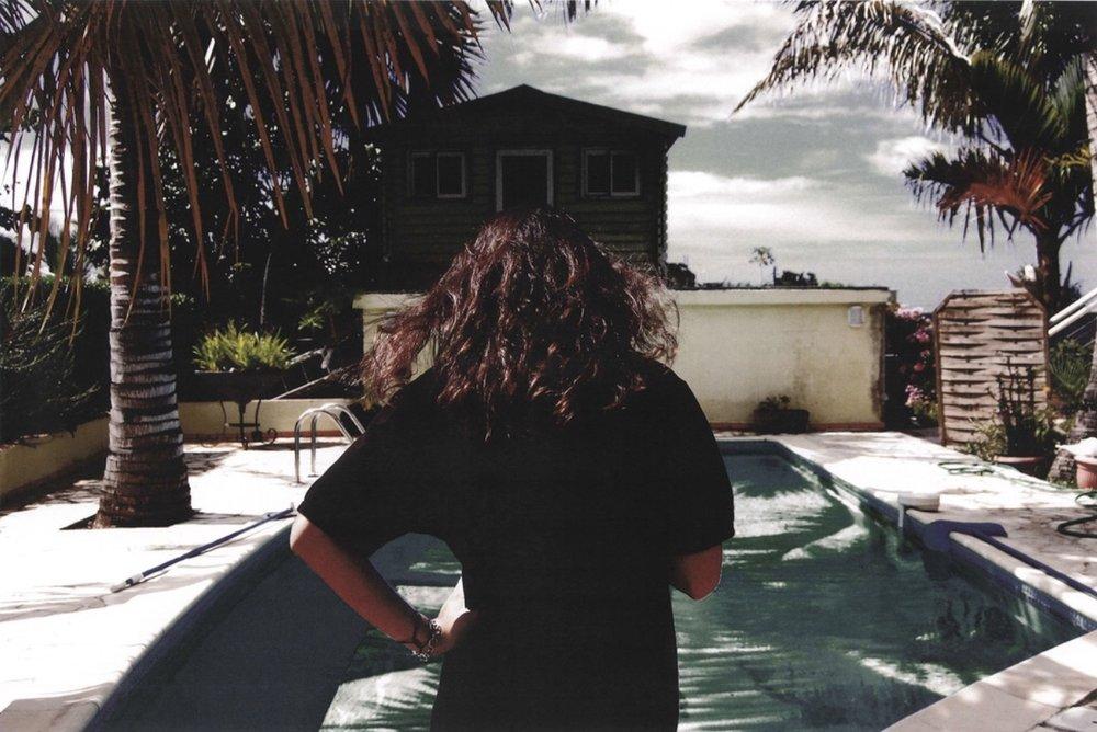 Krystie by the pool (from behind), 2010