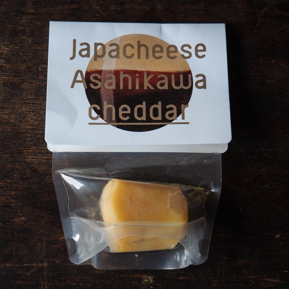 """Beer-washed cheddar using local milk from Asahikawa."""