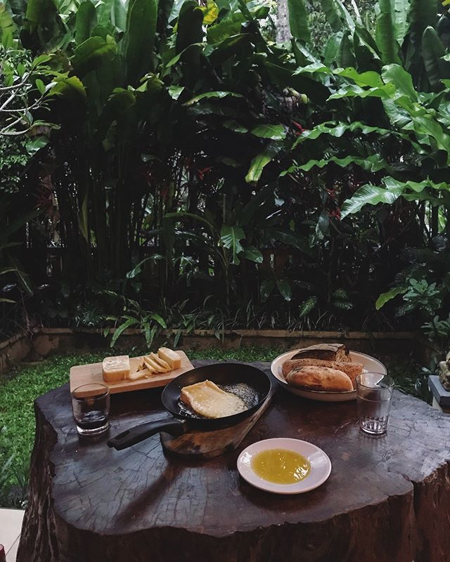 Full plates of cheese and wine glasses in need of topping up. We're still doing the cheese thing in Bali! The back-drop has just changed a little... 🌴🧀🌏