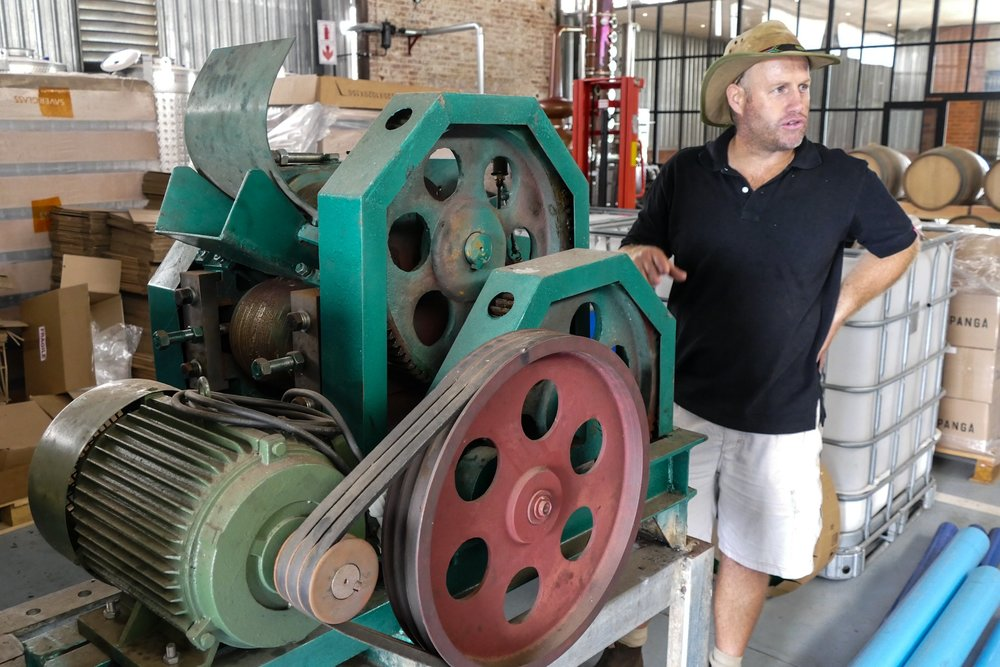 Mathias Wessels at the manual sugar cane crusher at Tapanga Rum.
