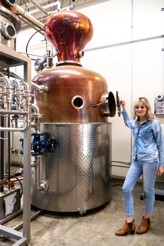 Morgan McLachlan at the 1000-liter Carl copper still at The Spirit Guild Distillery