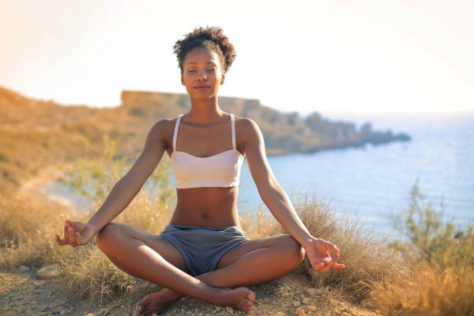 Black-woman-meditating-in-nature.jpg
