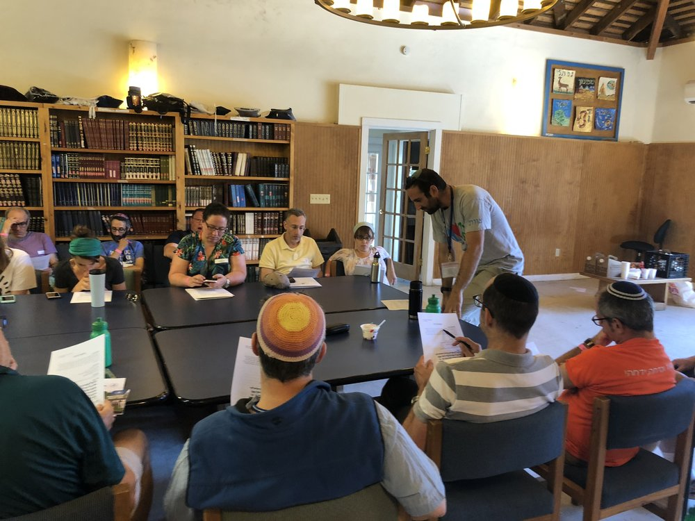 Dr. Jason Rogoff (standing, far right) at Camp Ramah in the Berkshires