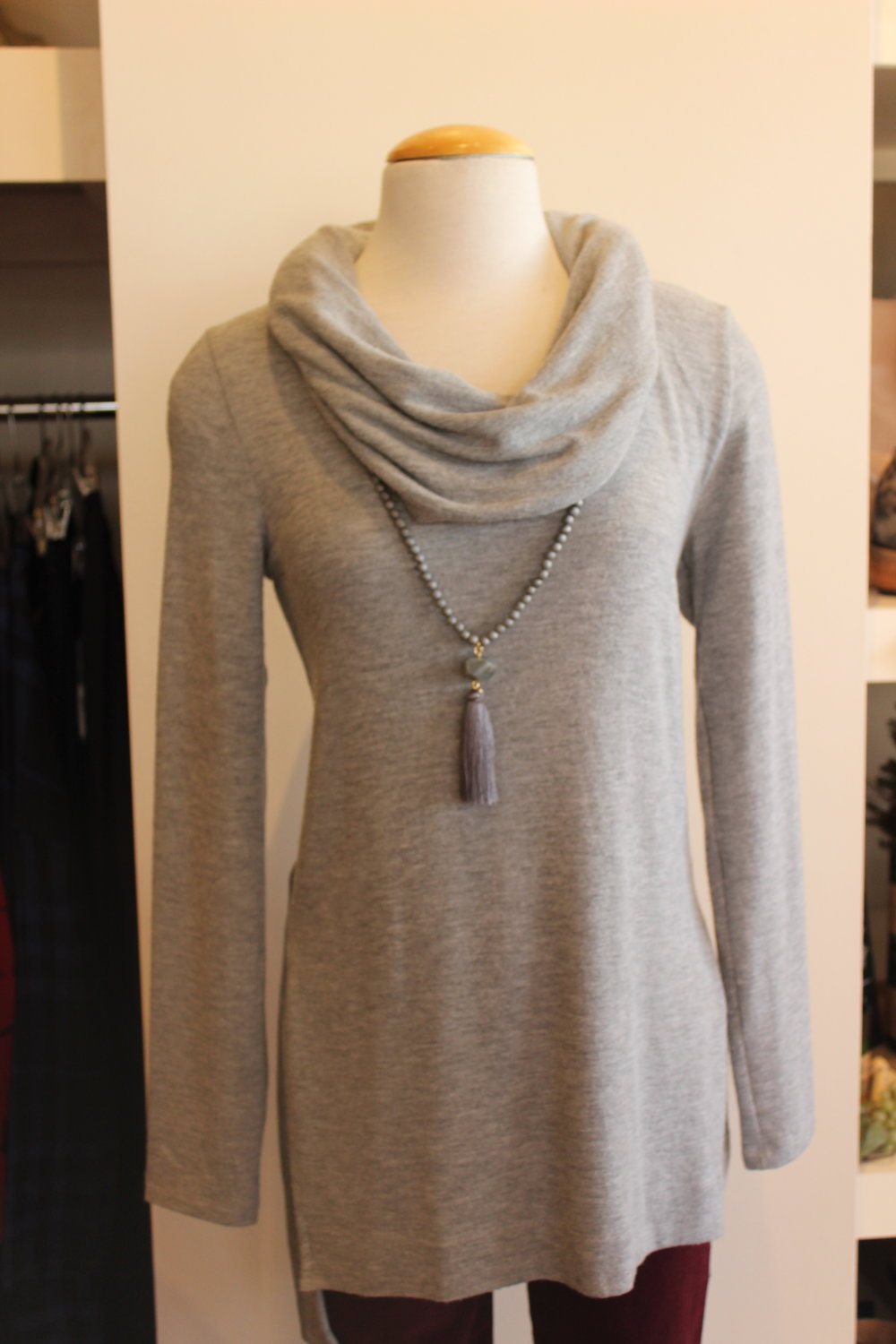 This Michael Stars cowl neck sweater is always a best seller! Made in the USA, the brushed jersey material makes it so soft and cozy! Perfect gift for any age or size. Colors: Heather grey, light pink, and oatmeal.