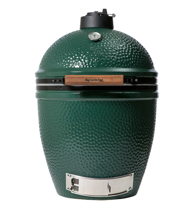 A happy couple can cook together on the Big Green Egg. It's the most versatile outdoor cooking product available. Find one locally at Bowling Green Fireplace & Grill.
