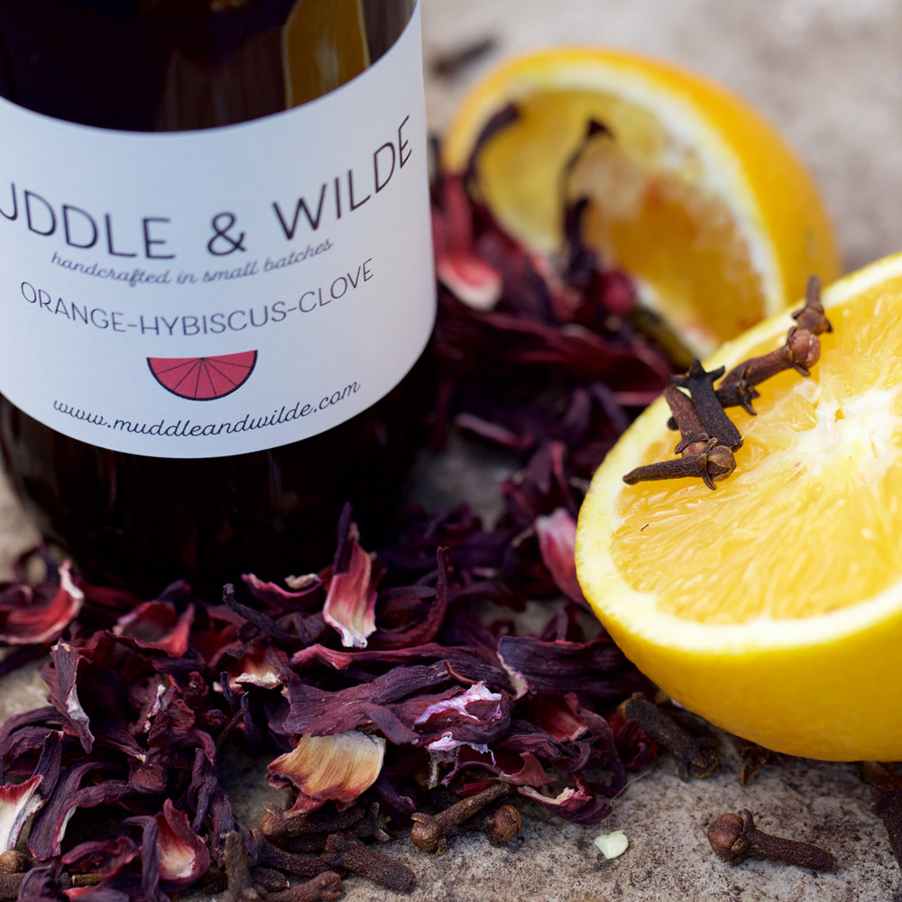 orange hibiscus clove - A perfect combination of citrusy orange, tart hibiscus and soothing clove. Mix with whisky, bourbon, vodka, sparkling wine & soda water.
