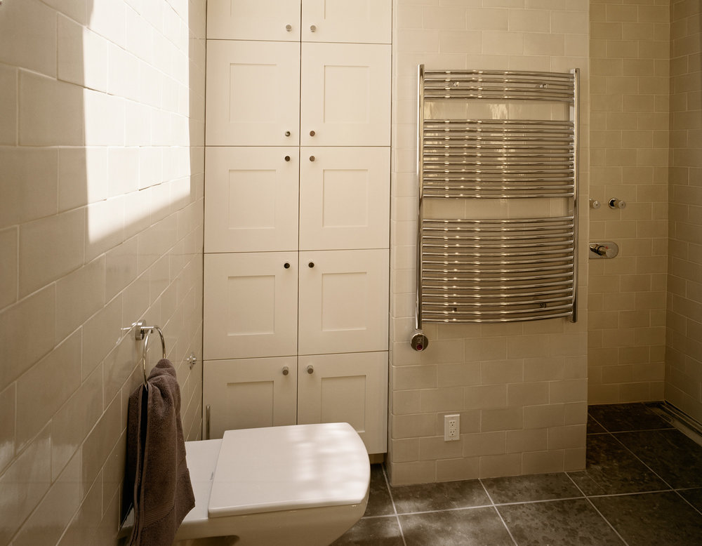 Wall mounted toilet and towel warmer.jpg