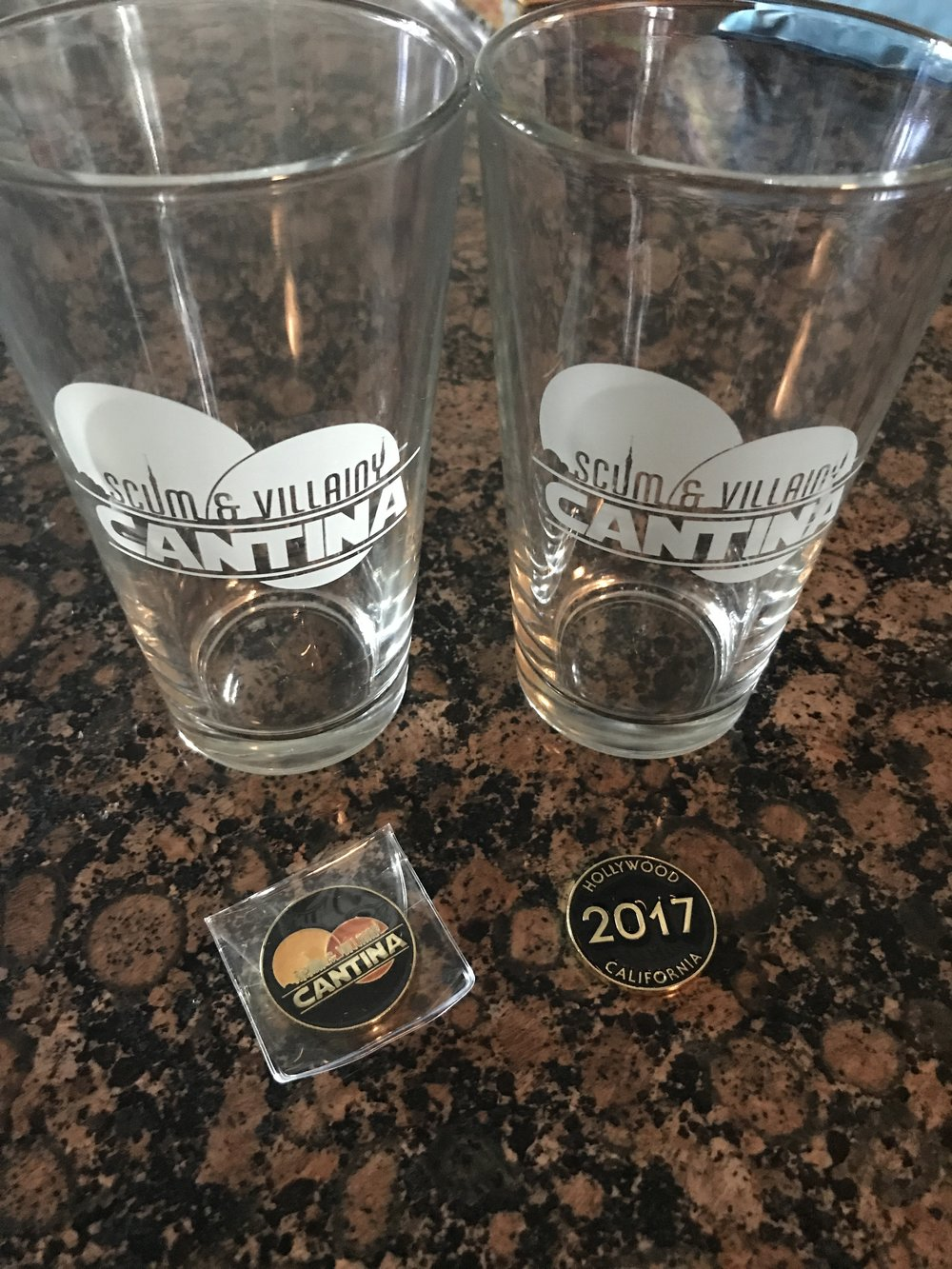 Scum & Villainy Cantina challenge coin and Pint glass - Star Wars Bar - Wandering Jokas Travel Blog
