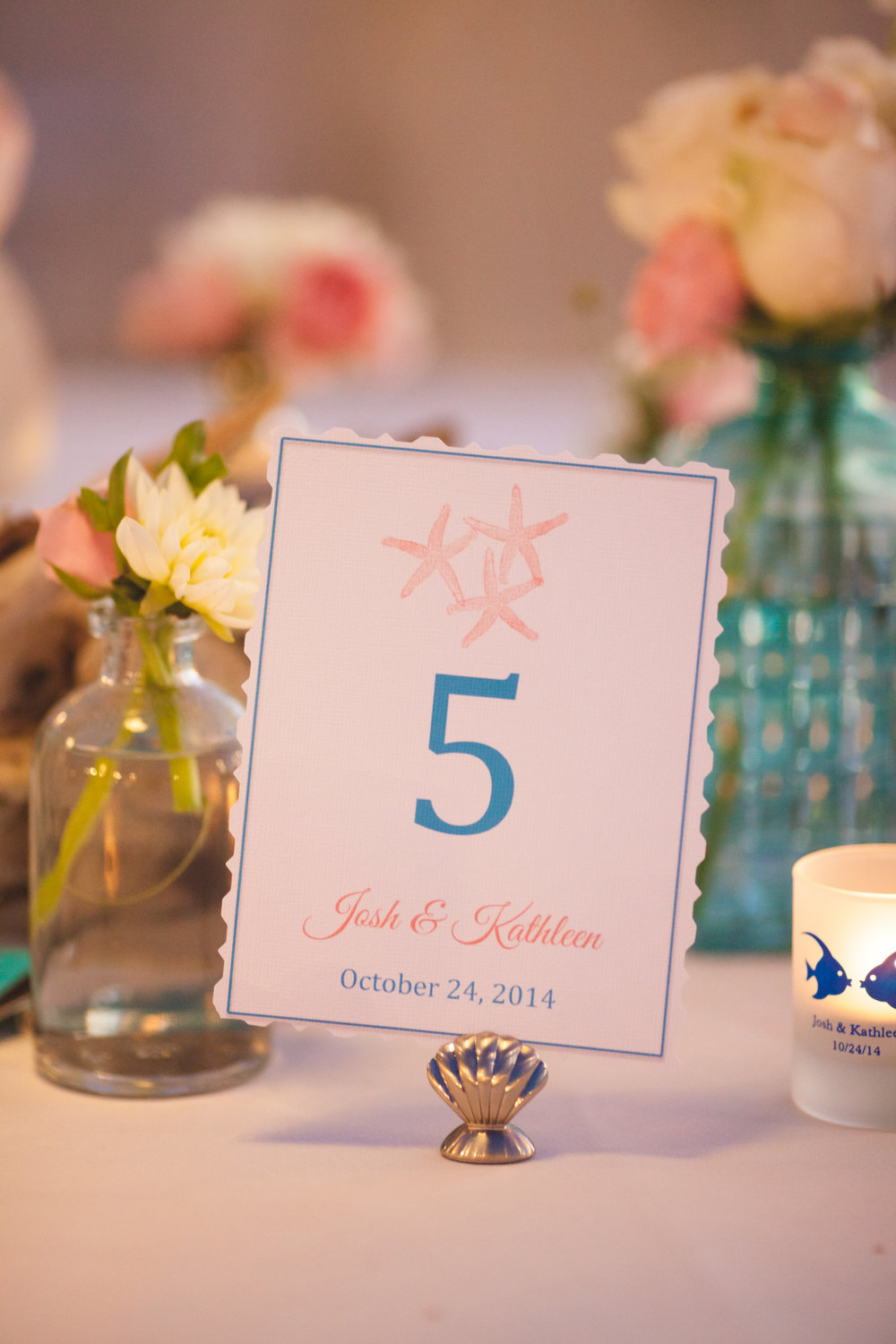 Table number and table settings for a beach destination wedding