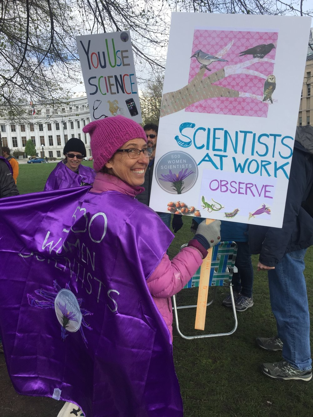 Sign-maker extraordinaire Jenny Devaud ready to march for science in Denver.