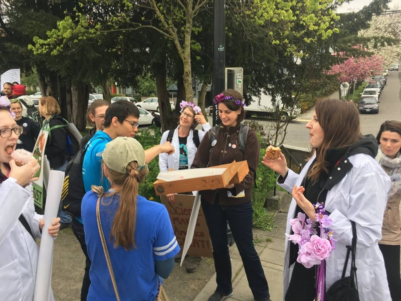 Laura passing out donuts before the Science March in Seattle to members of 500 Women Scientists Seattle and UAW 4121