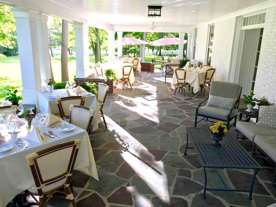 Elegant outdoor dining and casual lounging space make the Porch a great place to enjoy fine food and drinks.