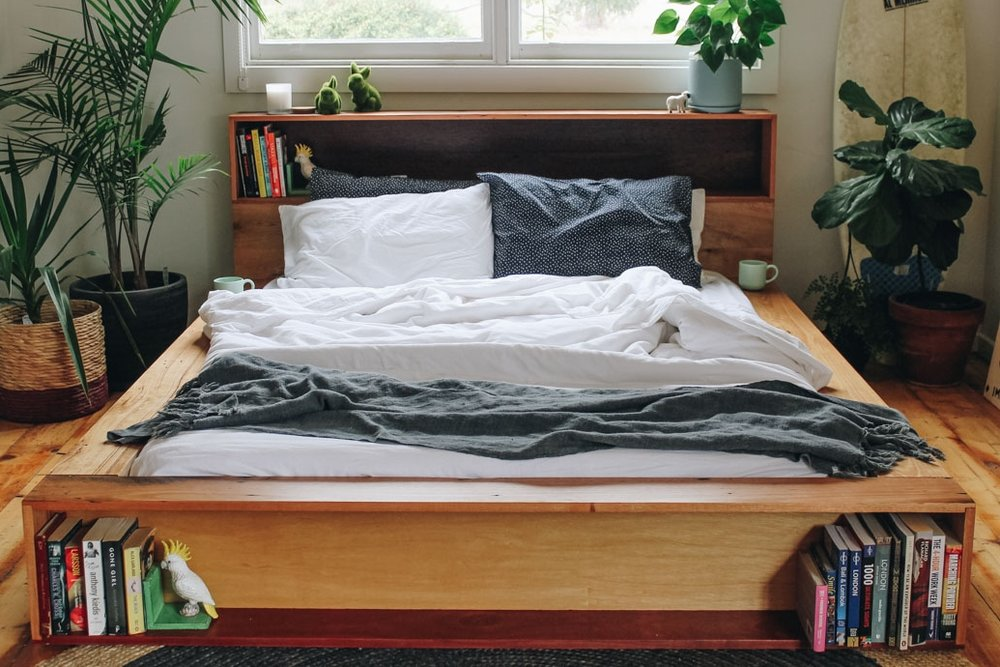 queen bed frame made out of recycled timber, platform with bookshelves
