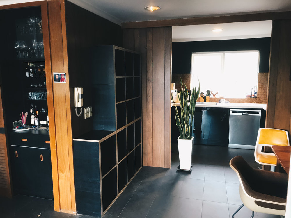 custom cabinetry made out of black plywood