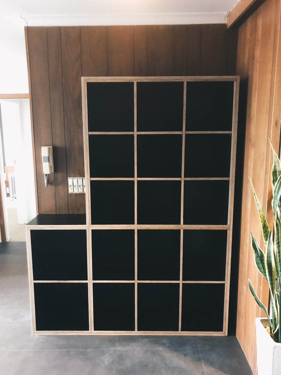 custom made black plywood shelving, cabinetry