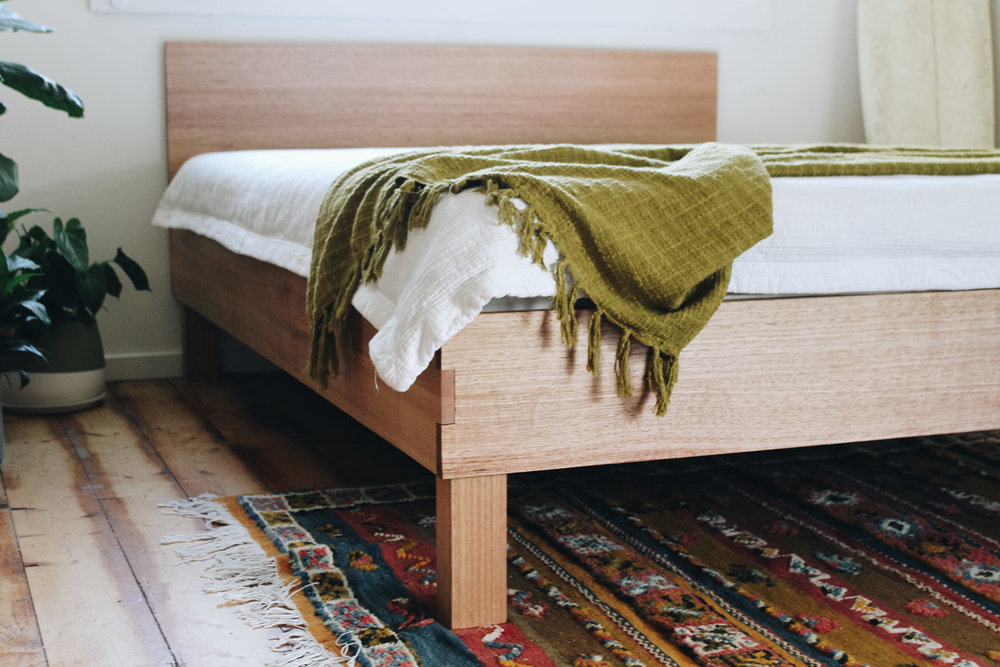 custom designed Queen size bed with solid headboard made out of recycled vic ash by al and imo handmade Melbourne