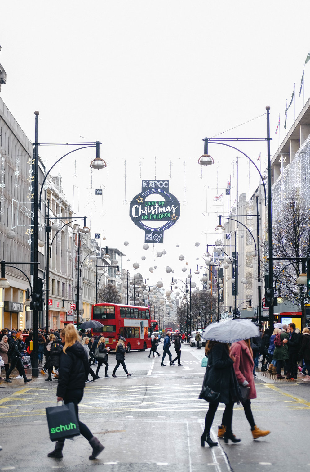 "<p style=""font-family:brandon-grotesque;font-weight:500; font-size:11px; text-center:left; color:light grey;letter-spacing: 1px"">DECEMBER 21, 2017 • CHRISTMAS ON OXFORD ST. • 📍 London, UK</p>"