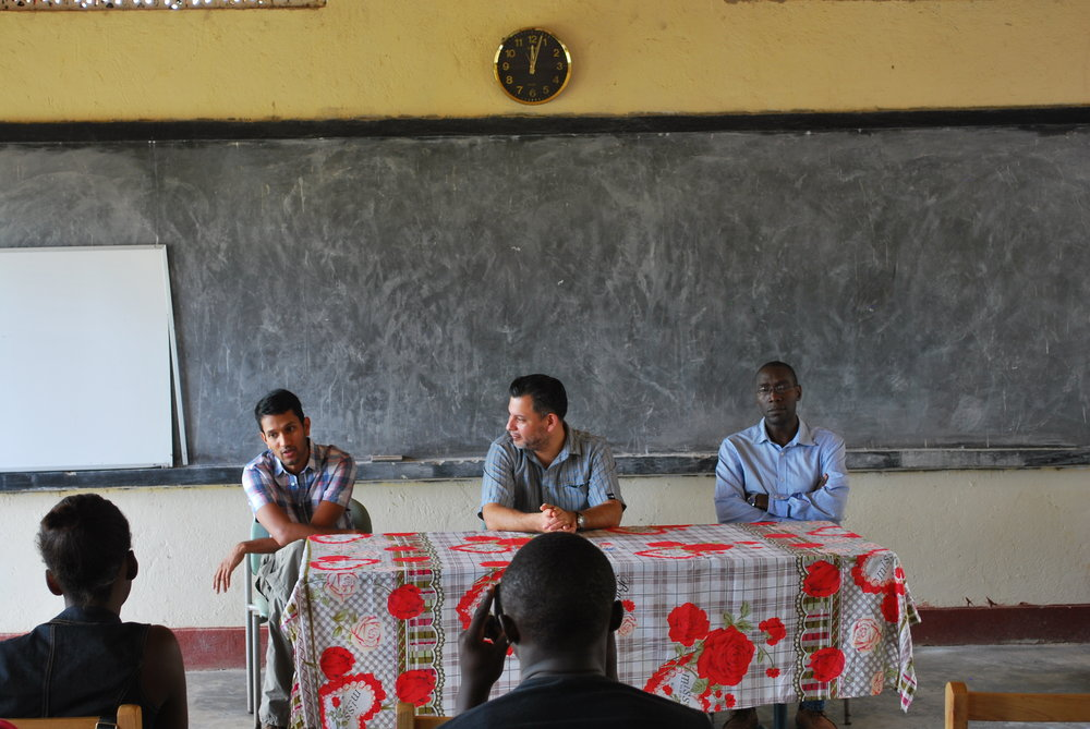 Dr. Trishul Siddharthan, Dr. William Checkley, and Dr. Robert Kalyesubula speak to nursing students at the African Community Centre for Social Sustainability (ACCESS) in Nakaseke.