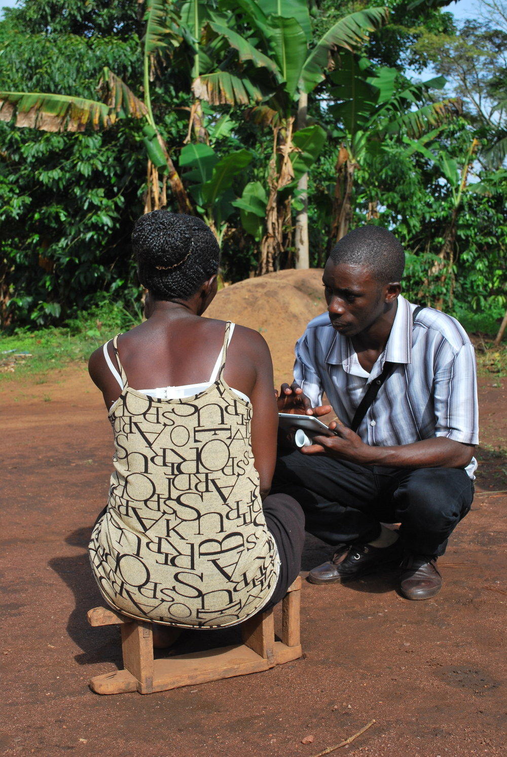 Field worker Denis interviews a study participant in Nakaseke.