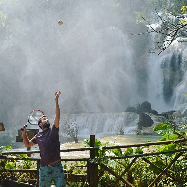 Fall-ing for Laos 🇱🇦! There's always time for a rapid serve 🎾🌊💨 #sprayingshotseverywhere #waterfall #trophypose #tick #justdoit 📸 @trav_ell