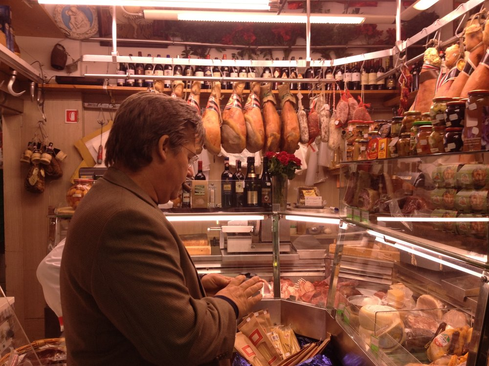 U.K. Culinary Professor Bob Perry visiting with his class at a typical market