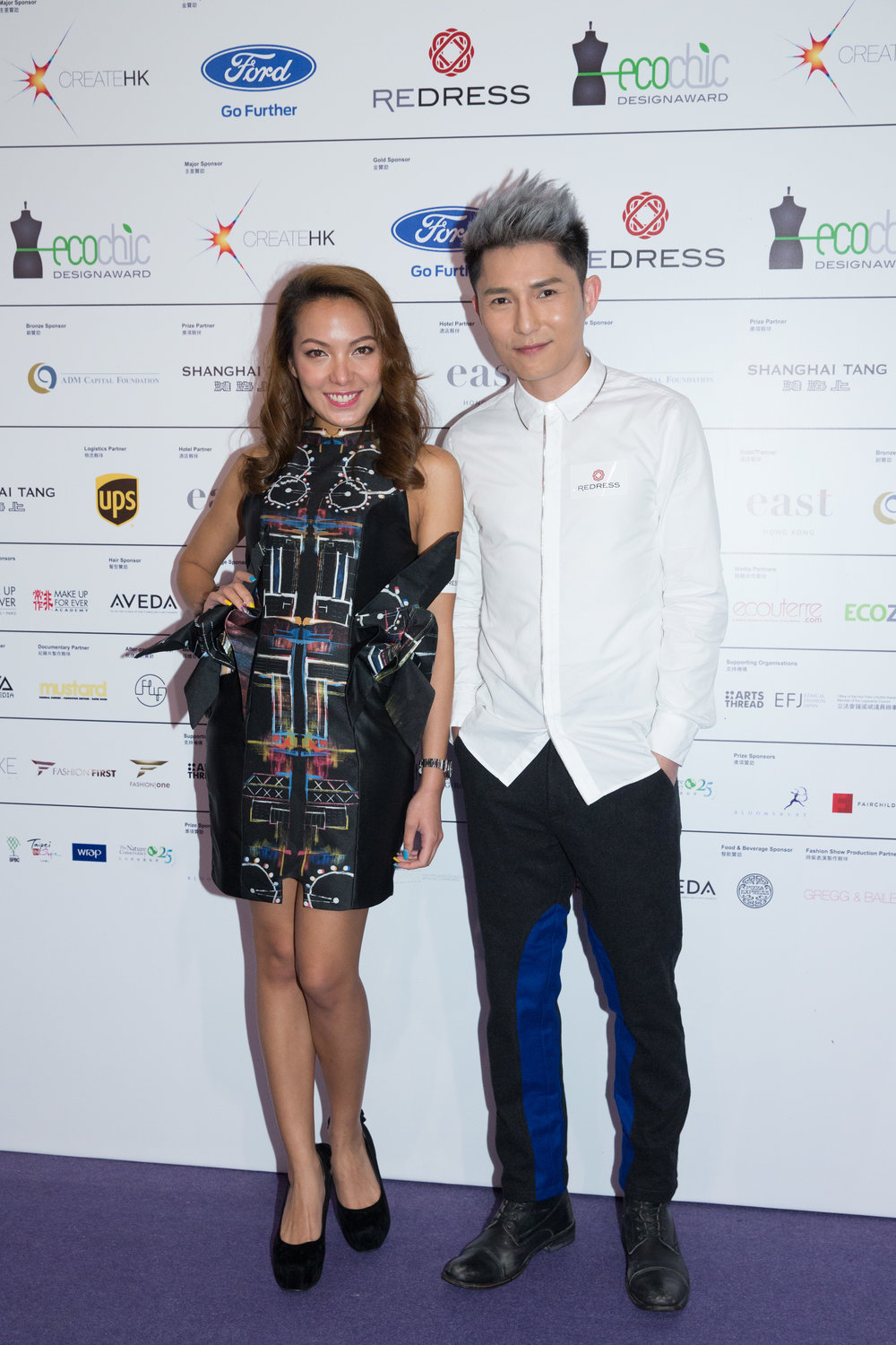 Hong Kong entertainers Sarki Choy and Ryan Lau wear Angus Tsui and Wan & Wong Fashion to attend the EcoChic Design Award 2015/16 Grand Final