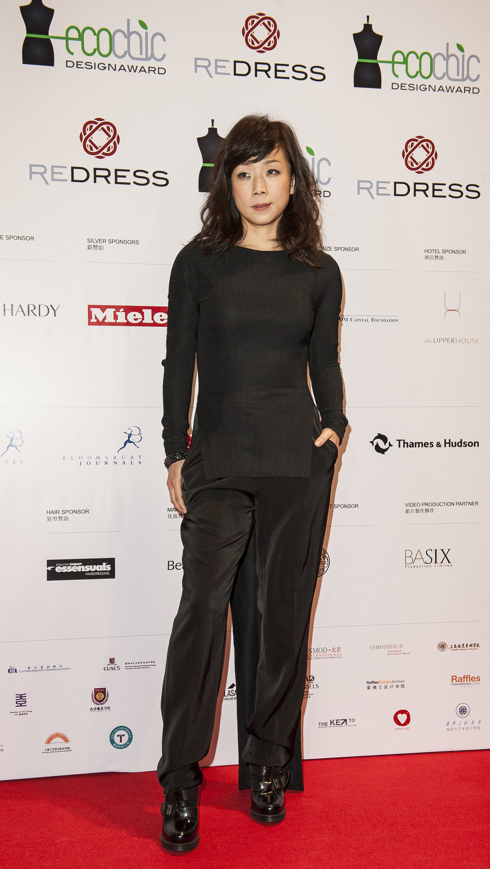 Chinese singer Sandy Lam wears Wan & Wong to attend the Redress Design Award 2013 Grand Final Show