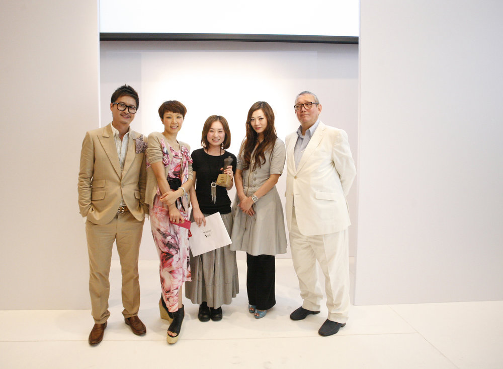 Redress Design Award judges Dorian Ho, Johanna Ho, Cecilia Yau and Andrew Sia present award to Redress Design Award 2011 cycle winner Janko Lam
