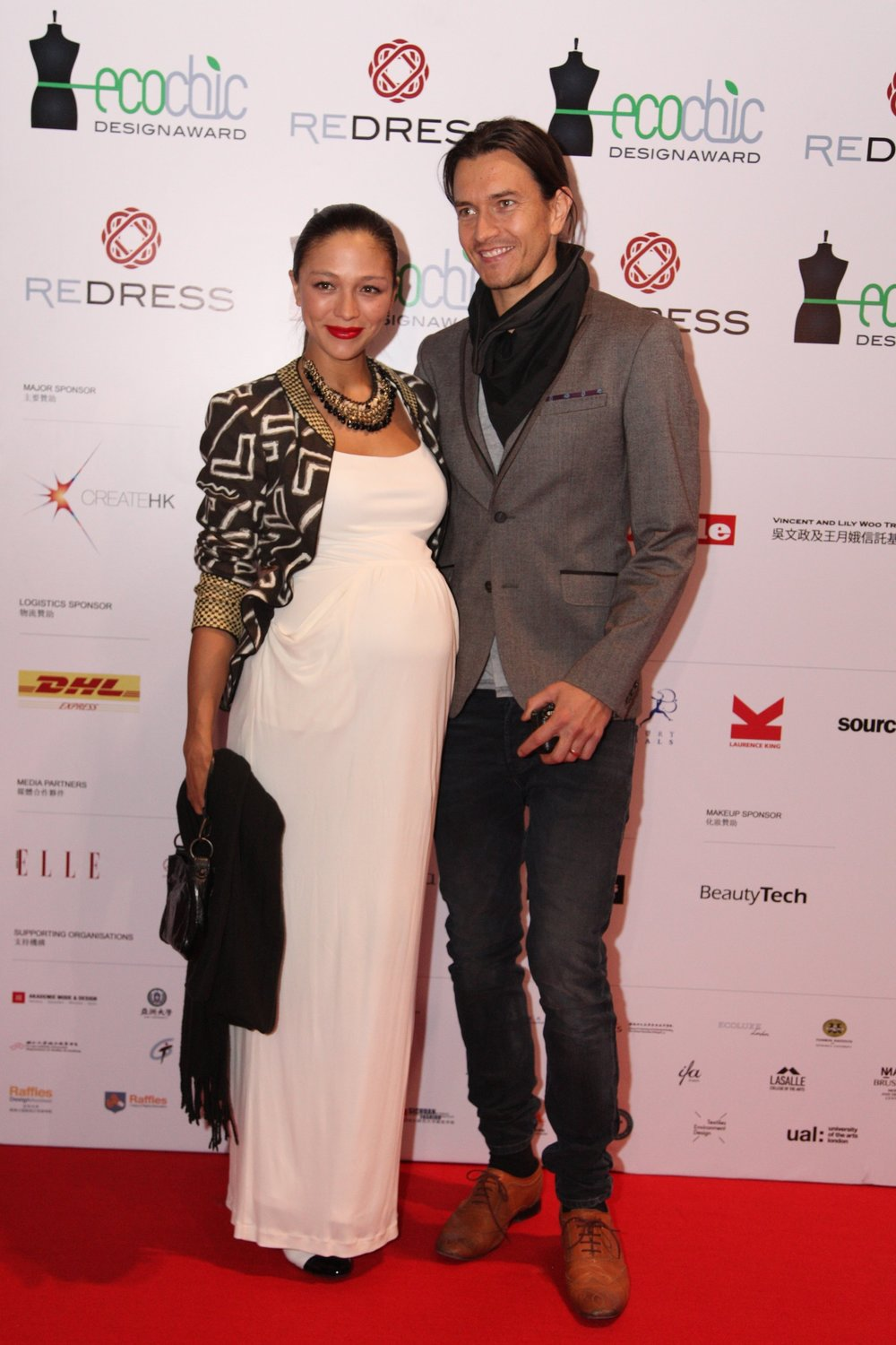 Hong Kong supermodel Cara G. McIlroy and her husband attend the Redress Design Award 2013 Grand Final Show