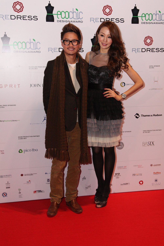 Designer Dorian Ho and Hong Kong supermodel Eunis Chan attend the Redress Design Award 2013 Grand Final Show